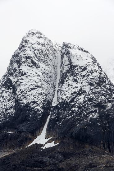 A Rugged Cone-Shaped Mountain Summit Dusted in Snow and Ice-Jason Edwards-Photographic Print