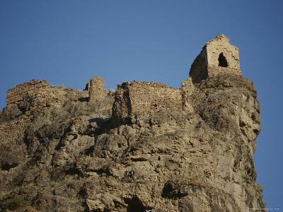 A Ruined Fortress Stands Upon a Rocky Hill-Stephen Alvarez-Photographic Print