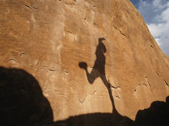 A Runners Shadow Falls on a Rock-Dugald Bremner-Photographic Print