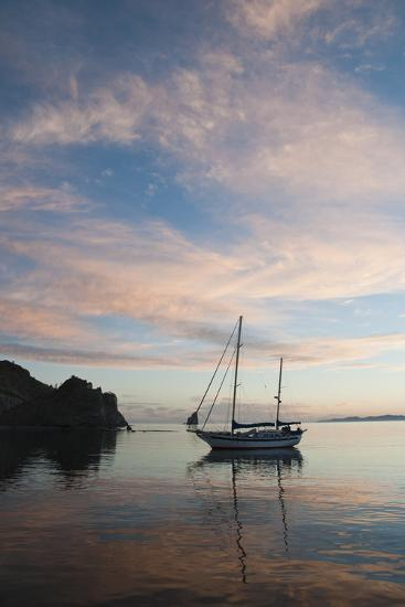 A Sailboat Anchored in a Bay During a Colorful Sunset-James Forte-Photographic Print