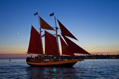 A Sailboat Carrying Tourists Returns to Port after a Sunset Sail-Mike Theiss-Photographic Print