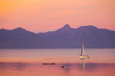 A Sailboat in Lake Villarrica's Flat Calm Water with Small Ripples, at Sunset-Mike Theiss-Photographic Print
