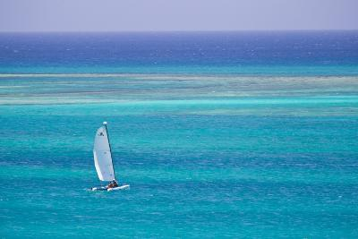 A Sailboat in the Turquoise Waters of the Caribbean Sea-Mike Theiss-Photographic Print