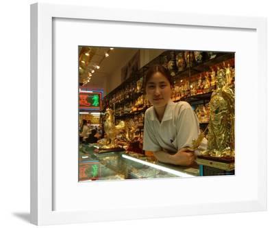 A Sales Girl at a Souvenir Shop-Richard Nowitz-Framed Photographic Print