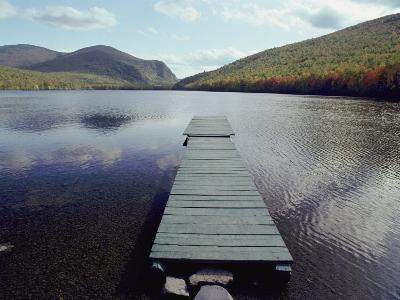 A Scenic View of a Dock on a Lake-Bill Curtsinger-Photographic Print