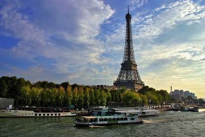 A Scenic View of the Eiffel Tower and a Ferry in the Seine River-Babak Tafreshi-Photographic Print