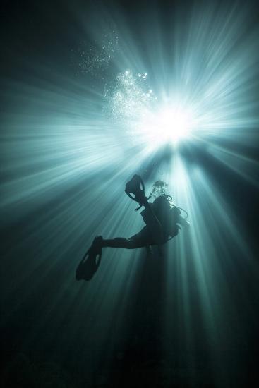 A Scuba Diver Ascends into the Light Emanating Above--Art Print