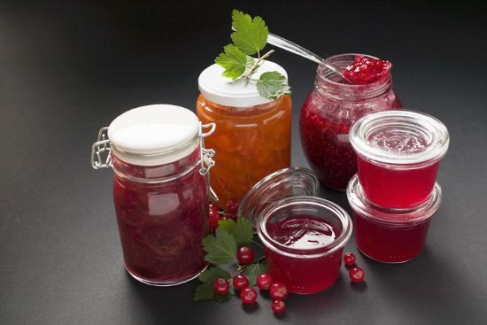 A Selection of Jams and Jelly in Jars, Redcurrants and Leaves-Foodcollection-Photographic Print
