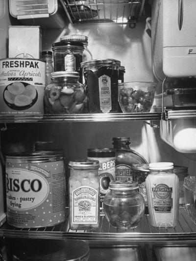 A Series of Pictures Showing How to Take Care of Electric Appliances - How to Store Food--Photographic Print
