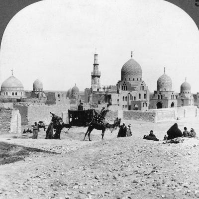 A 'Ship of the Desert' Passing Tombs of By-Gone Moslem Rulers, Cairo, Egypt, 1905-Underwood & Underwood-Photographic Print