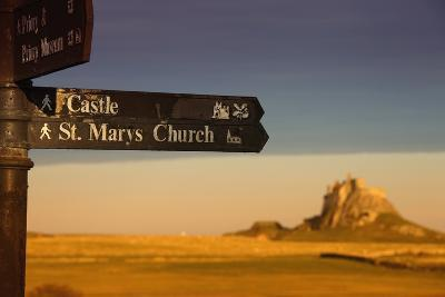 A Sign Post Pointing to a Castle and St. Marys Church on the Tidal Island-Design Pics Inc-Photographic Print