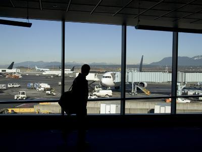 A Silhouette Walks Past a Window Looking Out at the Tarmac, Vancouver, British Columbia, Canada-Taylor S^ Kennedy-Photographic Print