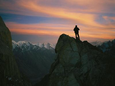 A Silhouetted Climber Watches the Sun Set over the Karakoram Mountains-Bobby Model-Photographic Print
