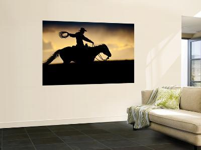 A Silhouetted Cowboy Riding Alone a Ridge at Sunset in Shell, Wyoming, USA-Joe Restuccia III-Wall Mural