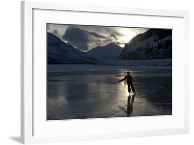 A Silhouetted Girl Skating on a Frozen Mountain Lake-Peter Mather-Framed Photographic Print