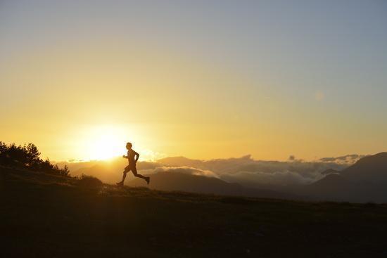 A Silhouetted Man Running Near the Verdon Gorge at Twilight-Keith Ladzinski-Photographic Print
