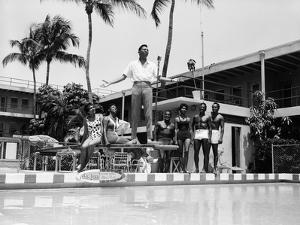 A Singer Entertains Guests, Poolside at the Sir John Hotel, May 11, 1962