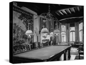 A Six-Lamped Brass Chandelier Hanging over the Pool Table in the Billard Room