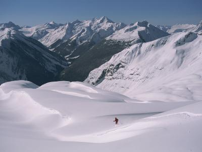 A Skier Heads Down Mount Swanzy-Tim Laman-Photographic Print