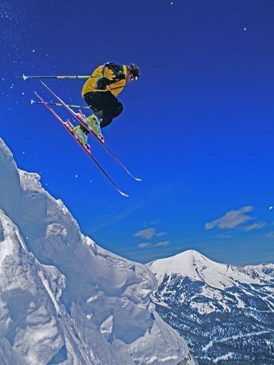 A Skier Jumps a Cornice at Exclusive Yellowstone Club Ski Area, Montana-Gordon Wiltsie-Photographic Print