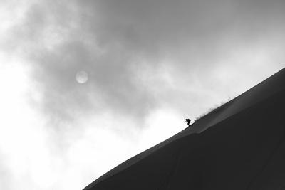 https://imgc.artprintimages.com/img/print/a-skier-runs-down-the-skyline-with-the-sun-behind-clouds_u-l-q1bv7n40.jpg?p=0
