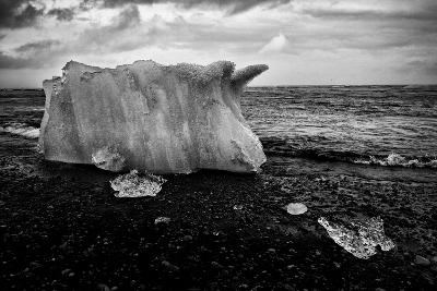 A Small Iceberg on a Volcanic Rock Beach at Jokulsarlon Lake, a Glacial Lagoon-Jonathan Irish-Photographic Print