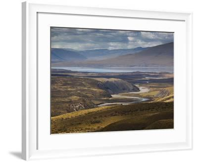 A Small River Runs into a Lake in Torres Del Paine National Park-Alex Saberi-Framed Photographic Print