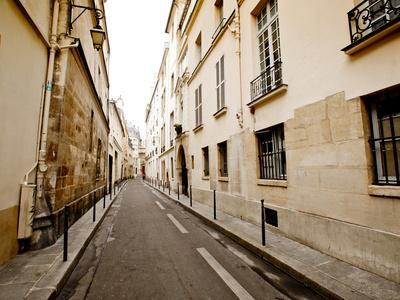 A Small Street Lined with Traditional Parisian Buildings-Jorge Fajl-Photographic Print