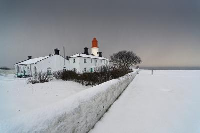 A Snow Covered Fence with a Lighthouse and Building in the Background; South Shields-Design Pics Inc-Photographic Print