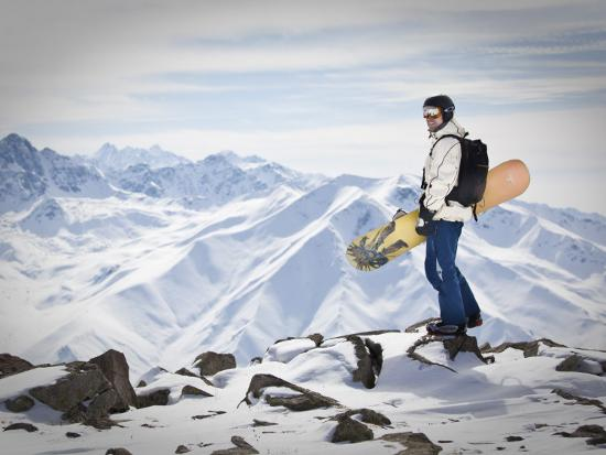 A Snowboarder at the Summit of Mount Affawat in Gulmarg, Kashmir, India-Julian Love-Photographic Print