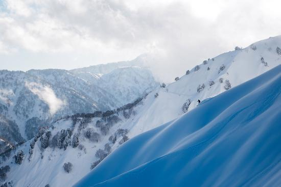 A Snowboarder Cuts a Turn into a Slope in the Backcountry Near Takayama-Max Lowe-Photographic Print