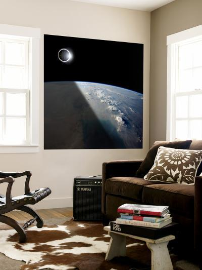 A Solar Eclipses Partially Shades the Earth Below-Stocktrek Images-Wall Mural