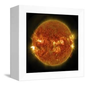 A Solar Flare Erupting on the Left Side of the Sun