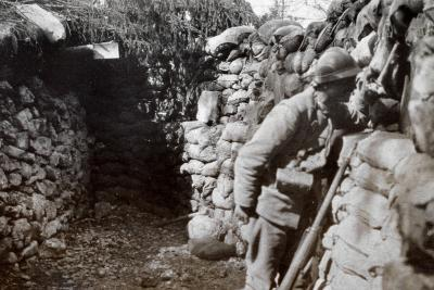A Soldier in a Trench Scans the Surrounding Territory--Photographic Print