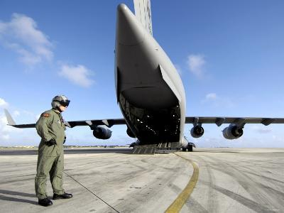 A Soldier Waits for His C-17 Globemaster III to Launch on an Upcoming Airdrop Mission-Stocktrek Images-Photographic Print