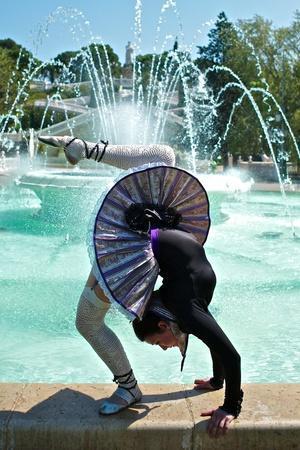 https://imgc.artprintimages.com/img/print/a-spanish-contortionist-and-dancer-in-a-aragonese-jotera-style-tutu_u-l-q19nnc60.jpg?p=0