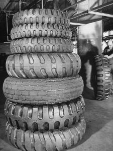 A Stack of Huge Earthmover and Combat Vehicle Tires Showing Deep Treads