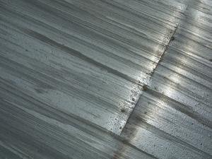 A Stained Metal Surface with a Long Scratch