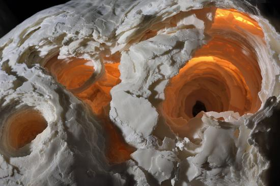 A stalagmite formation illuminated from within.-Joel Sartore-Photographic Print