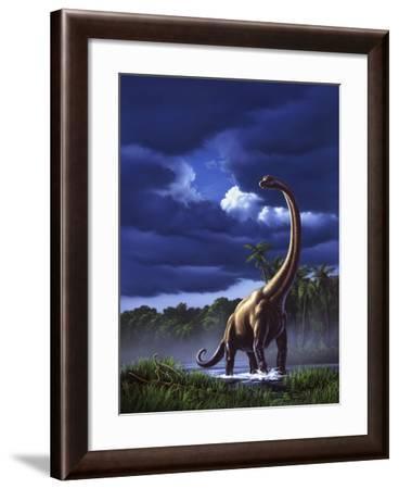 A Startled Brachiosaurus Splashes Through a Swamp Against a Stormy Sky--Framed Art Print