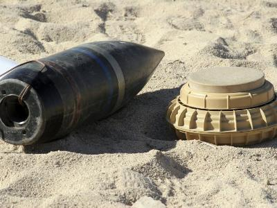A Static Display of a Converted Ordnance Shell and a Simple Mine-Stocktrek Images-Photographic Print