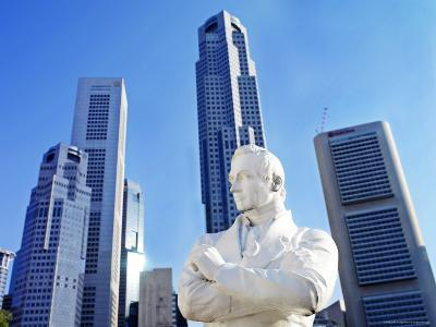 A Statue of Sir Stamford Raffles Against the Cityscape of Singapore-xPacifica-Photographic Print