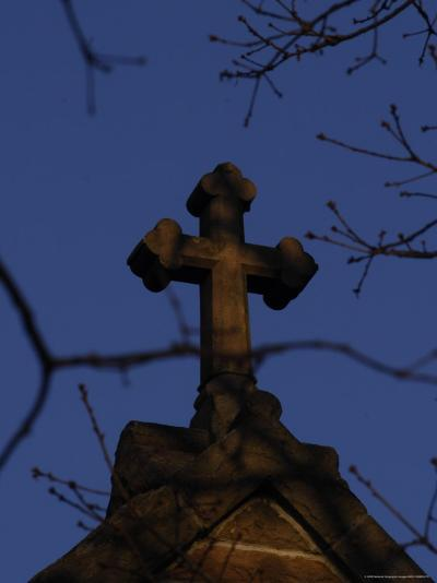 A Stone Cross Caps the Top of a Building-Stephen Alvarez-Photographic Print