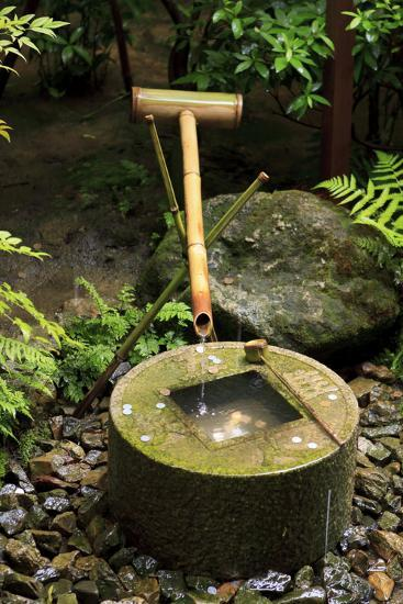 A Stone Water Basin in the Grounds of Ryoan-Ji Temple, Kyoto, Japan-Paul Dymond-Photographic Print
