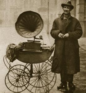 A Street Hawker Entertains with a Gramophone, Transported in a Pram