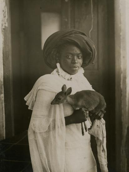 A Stylish Young Kenyan Woman Holding Her Pet Deer-Underwood & Underwood-Photographic Print