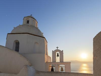A Summer Sunset on the Mediterranean Island of Santorini, with a Historic Church and a Bell Tower-Babak Tafreshi-Photographic Print