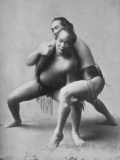 A sumo wrestling bout between a pair of Japanese professionals, 1902-Unknown-Photographic Print