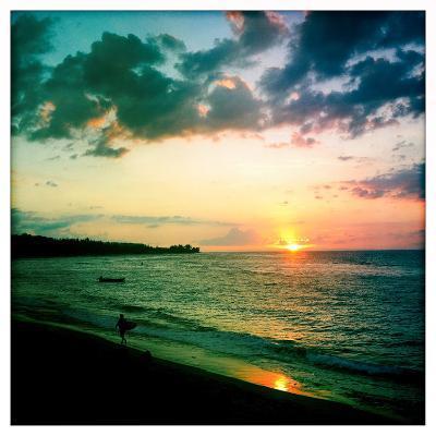 A Surfer Heading Home at Sunset on Shacks Beach Near Aquadilla, Puerto Rico-Skip Brown-Photographic Print