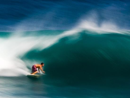 A Surfer Pulls into the Barrel on a Big Day at Uluwatu-Ben Horton-Photographic Print